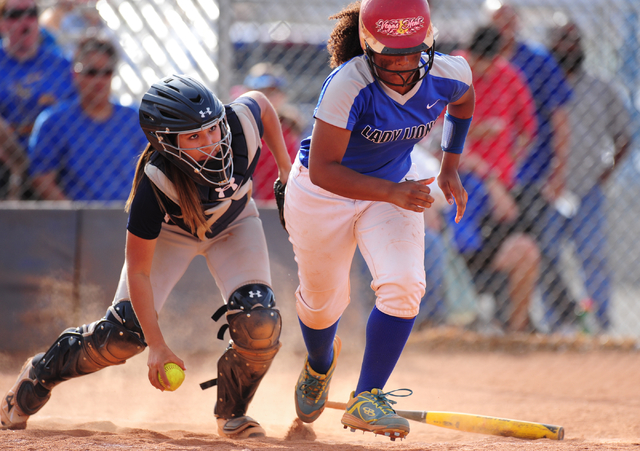 Spring Valley catcher Vivian Quiroz-Montano throws out Sierra Vista batter Harmony Dominguez after Dominguez tried to advance to third base after striking out in the seventh inning of their prep s ...