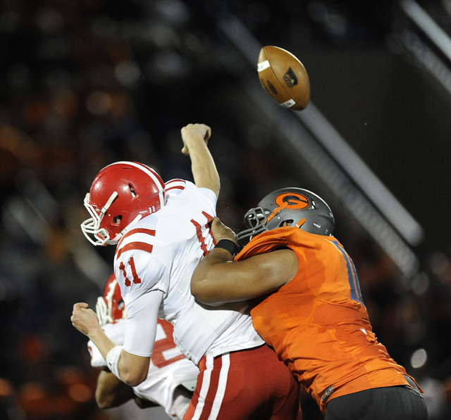 Bishop Gorman's Haskell Garrett, right, knocks the ball out of the hands of Brophy Prep quarterback Cade Knox (11) in the first half of the Sollenberger Classic on Friday. (Josh Holmberg/Las Vegas ...