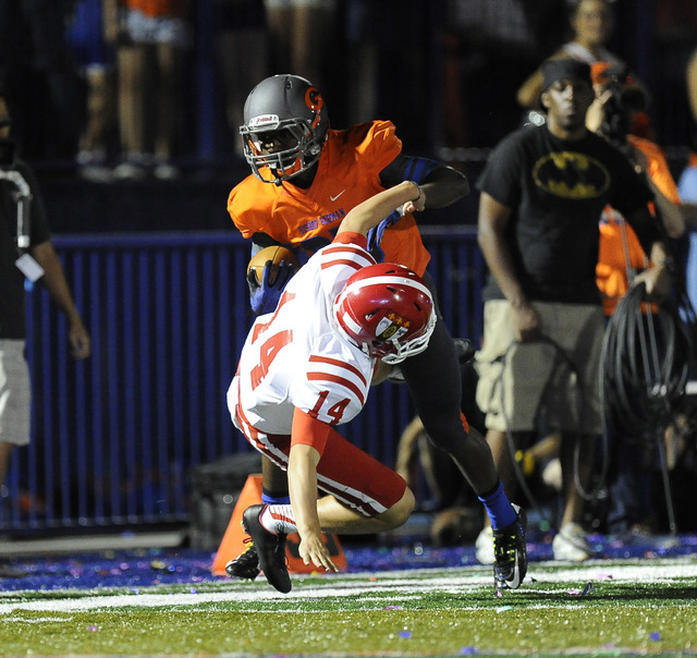 Bishop Gorman's Tyjon Lindsey runs over Brophy Prep punter Jack Katzman (14) while returning a punt in the first half earlier this season. (Josh Holmberg/Las Vegas Review Journal)