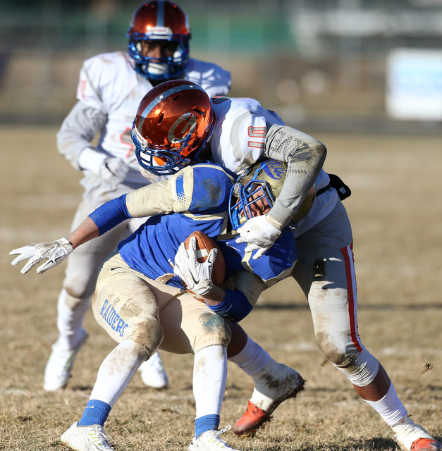 Bishop Gorman's Palaie Gaoteote tackles Reed's Jorden Carter in an NIAA Division I playoff game at Reed High School in Sparks, Nev., on Saturday, Nov. 28, 2015. Bishop Gorman won 41-13. (Cathleen  ...
