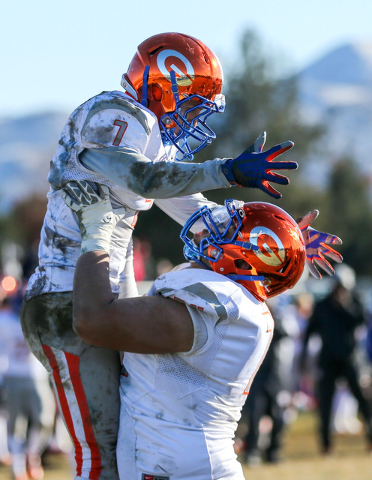 Bishop Gorman's Biaggio Ali Walsh (7) and Julio Garcia II (74) celebrate a touchdown against Reed in an NIAA Division I playoff game at Reed High School in Sparks, Nev., on Saturday, Nov. 28, 2015 ...