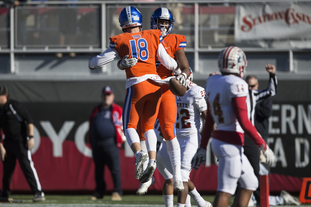 Brevin Jordan (9) celebrates his touchdown with Tate Martell (18) against Liberty in the Class 4A state football championship game at Sam Boyd Stadium on Saturday, Dec. 3, 2016, in Las Vegas. Erik ...