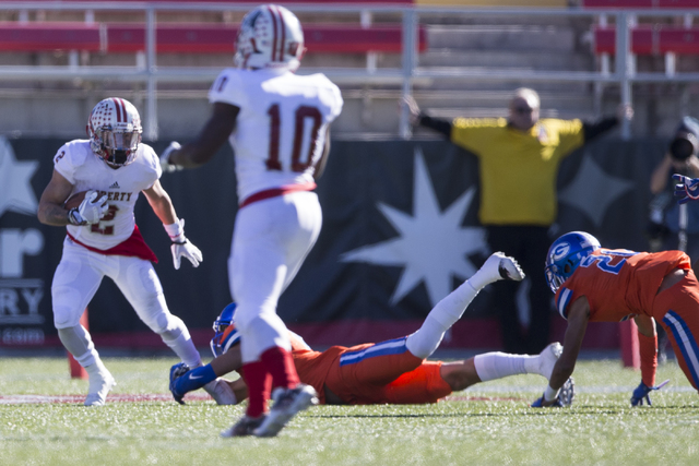 Liberty's Ethan Dedeaux (2) runs the ball against Bishop Gorman in the Class 4A state football championship game at Sam Boyd Stadium on Saturday, Dec. 3, 2016, in Las Vegas. Bishop Gorman won 84-8 ...