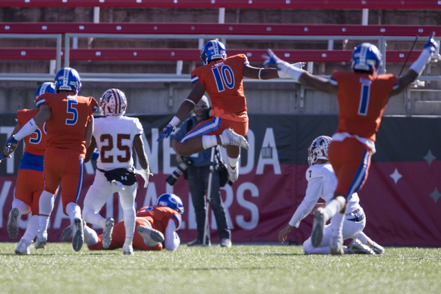 Bishop Gorman players celebrate a touchdown by Austin Arnold (6) against Liberty in the Class 4A state football championship game at Sam Boyd Stadium on Saturday, Dec. 3, 2016, in Las Vegas. Erik  ...