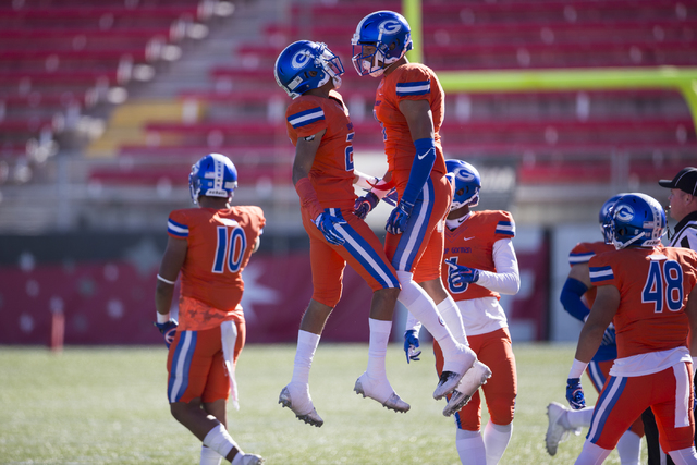 Bishop Gorman Greg Oliver (20), left, celebrates his interception with Damuzhea Bolden in the Class 4A state football championship game at Sam Boyd at Sam Boyd Stadium on Saturday, Dec. 3, 2016, i ...
