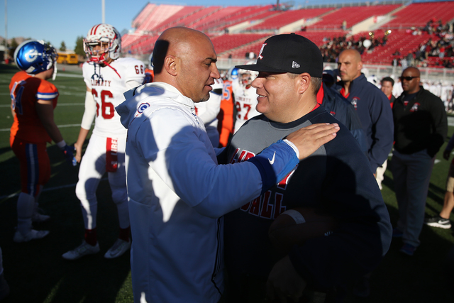 Bishop Gorman's head football coach Kenny Sanchez, left, and Liberty's head football coach Rich Muraco speak after their game in the Class 4A state football championship game at Sam Boyd Stadium o ...