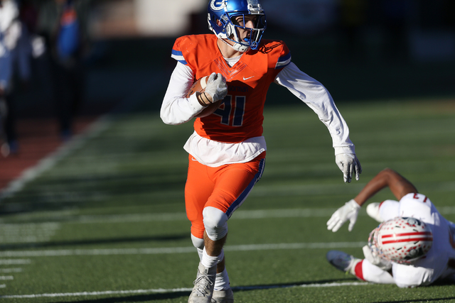 Bishop Gorman's Brock Ruggeroli (41) runs the ball for a touchdown against Liberty in the Class 4A state football championship game at Sam Boyd Stadium on Saturday, Dec. 3, 2016, in Las Vegas. Bis ...