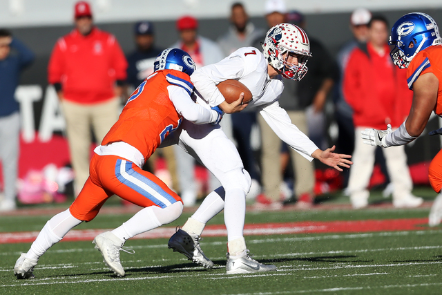 Bishop Gorman's Joey Mazzara (25) sacks Liberty's Kenyon Oblad (7) in the Class 4A state football championship game at Sam Boyd Stadium on Saturday, Dec. 3, 2016, in Las Vegas. Bishop Gorman won 8 ...