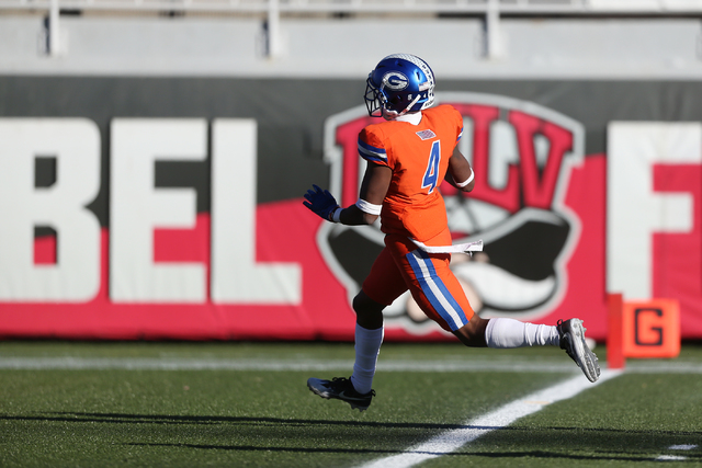 Bishop Gorman's Alex Perry (4) runs the ball for a touchdown against Liberty during the Class 4A state football championship game at Sam Boyd Stadium on Saturday, Dec. 3, 2016, in Las Vegas. Bisho ...