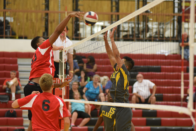 Tech's Sir-Issak Singleton (33) spikes the ball against Clark during their Division I-A state volleyball quarterfinals at Tech High School in Las Vegas on Monday, May 16, 2016. Tech defeated Clark ...