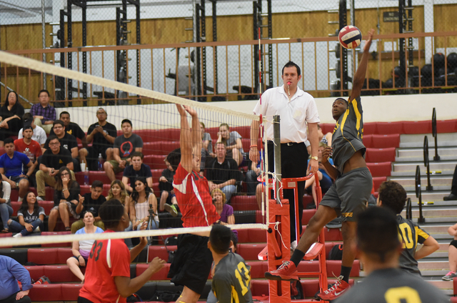 Clark's Amir Boone (15) spikes the ball against Tech during their Division I-A state volleyball quarterfinals at Tech High School in Las Vegas on Monday, May 16, 2016. Tech defeated Clark 3-2. Mar ...