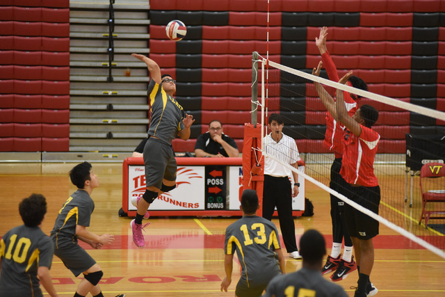Clark's Alan Cruz (8) spikes the ball against Tech during their Division I-A state volleyball quarterfinals at Tech High School in Las Vegas on Monday, May 16, 2016. Tech defeated Clark 3-2. Marti ...