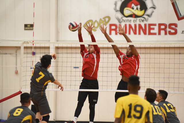 Tech's Juan Flores (3) and Sir-Issak Singleton (33) try to block a spike by Clark's Sang Hyup Shin (7) during their Division I-A state volleyball quarterfinals at Tech High School in Las Vegas on  ...