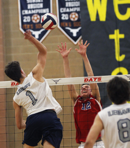 Legacy's Tanner Compton (1) goes up for the kill over Valley's Marty Heavey (12) during the Division I state tournament on Tuesday. Legacy defeated Valley, 3-0.(Jason Bean/Las Vegas Review-Journal)