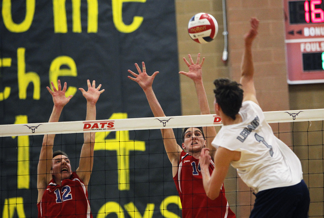 Legacy's Tanner Compton (1) goes up for the kill over Valley's Marty Heavey (12) and Matt Ballaro (14) during the Division I state tournament on Tuesday. Legacy defeated Valley, 3-0.(Jason Bean/La ...
