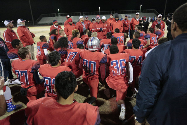 Liberty team members take a knee after winning the Sunrise Region championship Game on Friday. The Patriots topped visiting Basic, 28-16. (Donavon Lockett/Las Vegas Review-Journal)