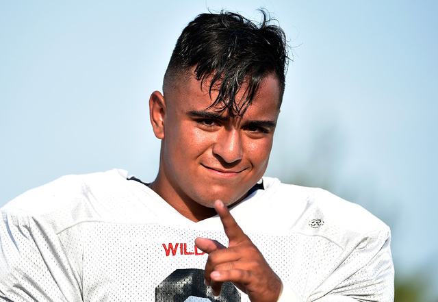 Las Vegas High linebacker Cruz Littlefield mugs for the camera before a scrimmage against Green Valley at Green Valley High School Friday, Aug. 19, 2016, in Henderson. David Becker/Las Vegas Revie ...