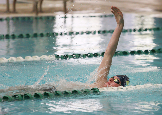 Faith Lutheran senior Bowen Becker, 17, swims the backstroke during a warm-up at practice at Pavilion Center Pool Wednesday, March 11, 2015, in Las Vegas. The freestyle sprinter is committed to th ...