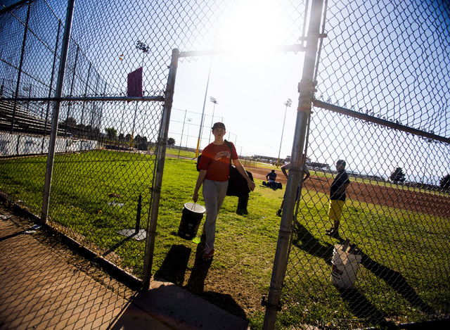 A Tech baseball player carries equipment after practice at the Silver Bowl park baseball field near Sam Boyd Stadium on Monday. Tech's sports teams have to practice and play at remote locations be ...
