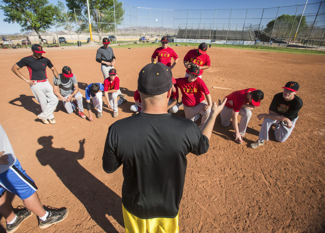 Tech baseball coach Bill Stuber talks to his team during practice at the Silver Bowl park baseball field near Sam Boyd Stadium on Monday. Tech's sports teams have to practice and play at remote lo ...