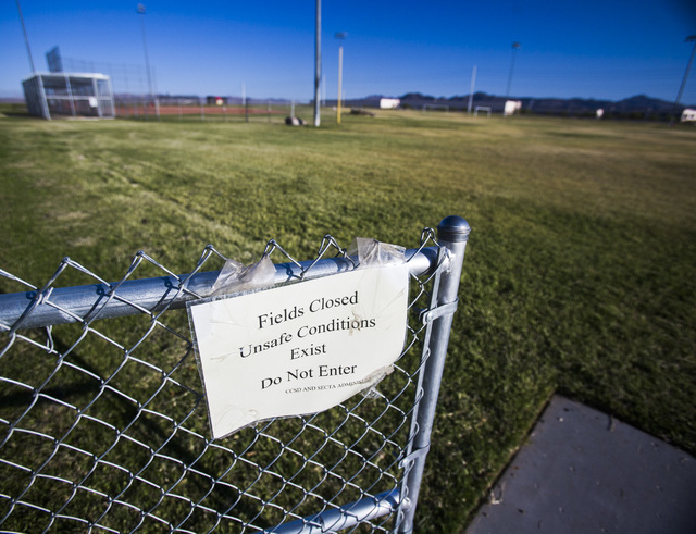 A sign posted at Tech's athltic sports fields, states that the fields are closed. Tech's sports teams have to practice and play at remote locations because the of sinkholes at the school's athleti ...