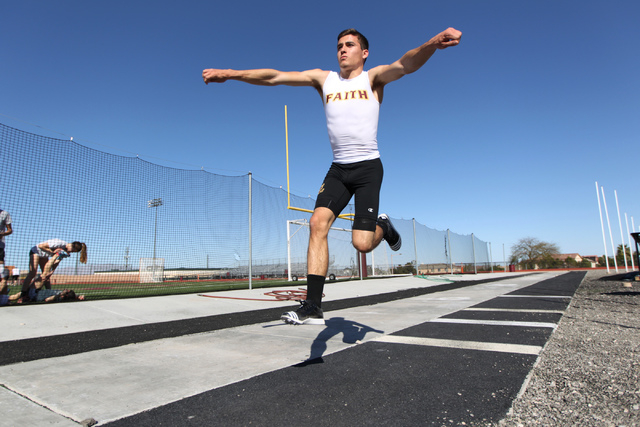 Faith Lutheran runner Mark Rubalcaba, 18, works on his long jumps during a track practice at Faith Lutheran High School in Las Vegas Monday, March 9, 2015. Rubalcaba is the defending I-A state men ...