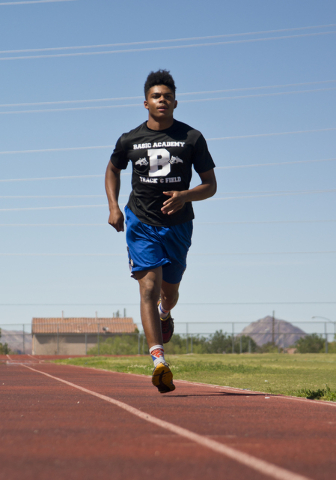 Basic High School high jumper Frank Harris runs warm up laps during track practice at Basic High School on Tuesday, May 2, 2016. Daniel Clark/Las Vegas Review-Journal Follow @DanJClarkPhoto