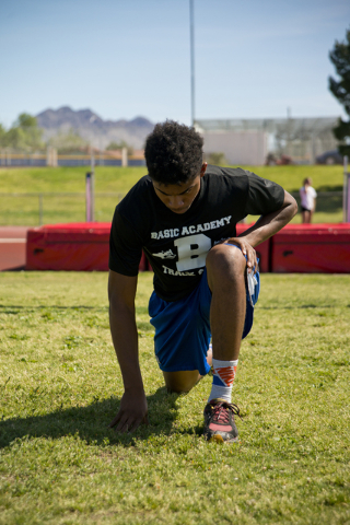 Basic High School high jumper Frank Harris stretches during track practice at Basic High School on Tuesday, May 2, 2016. Daniel Clark/Las Vegas Review-Journal Follow @DanJClarkPhoto