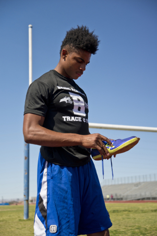 Basic High School high jumper Frank Harris puts on his shoes during track practice at Basic High School on Tuesday, May 2, 2016. Daniel Clark/Las Vegas Review-Journal Follow @DanJClarkPhoto