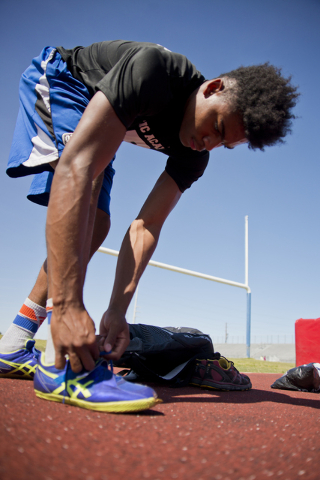 Basic High School high jumper Frank Harris laces his shoes during track practice at Basic High School on Tuesday, May 2, 2016. Daniel Clark/Las Vegas Review-Journal Follow @DanJClarkPhoto