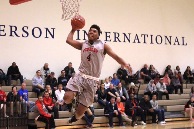 Findlay Prep guard Allonzo Trier leaps to dunk against Westwind during their game Tuesday, Nov. 25, 2015 at Henderson International School. (Sam Morris/Las Vegas Review-Journal)