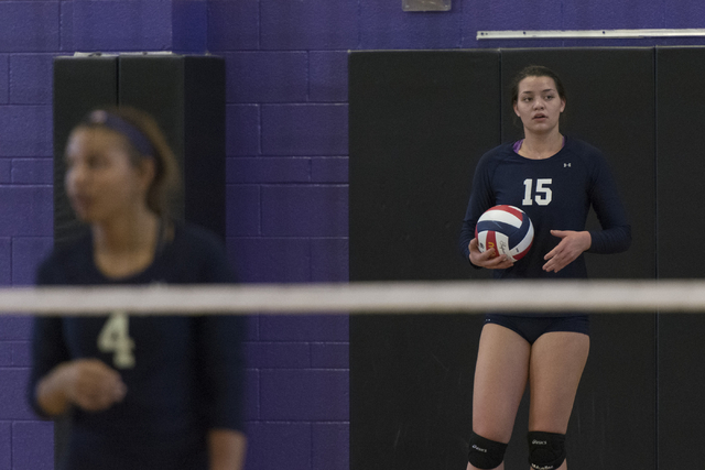 Shadow Ridge's Whittnee Nihipali (15), right, prepares to serve the ball against Durango during a Sunset Region girls volleyball semifinal match at Durango in Las Vegas, Thursday, Nov. 3, 2016. Ja ...