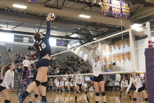 Shadow Ridge's Whittnee Nihipali (15), left, hits the ball against Durango during a Sunset Region girls volleyball semifinal match at Durango in Las Vegas, Thursday, Nov. 3, 2016. Jason Ogulnik/La ...