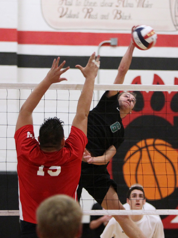 Palo Verde's Parker Nelson gets a shot past Las Vegas' Mark Gil Gacutan during their Division I state volleyball semifinal Tuesday, May 12, 2015 at Las Vegas High. Palo Verde won 3 games to 1. (Sa ...