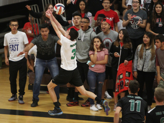 Palo Verde's Jonathan Hecker chases an errant ball near Las Vegas fans during their Division I state volleyball semifinal Tuesday, May 12, 2015 at Las Vegas High. Palo Verde won 3 games to 1. (Sam ...