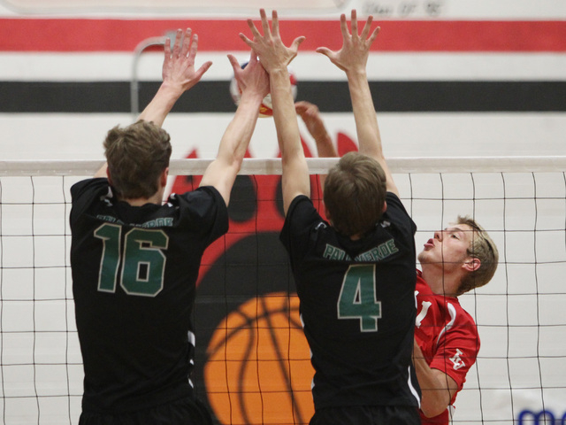 Palo Verde's Tyler Klingensmith, left, and Cole Willson block a shot by Las Vegas' Brandon Kampshoff during their Division I state volleyball semifinal Tuesday, May 12, 2015 at Las Vegas High. Pal ...