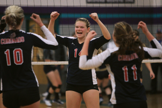 Coronado's Cali Thompson, center, and teammates celebrate winning a point during their Sunrise Region volleyball championship game against Foothill on Friday. Coronado won 25-10, 25-18, 25-7. (Sam ...