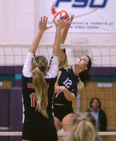 Coronado's Cali Thompson, left, leaps to block a shot by Foothill's Rebecca Hill during their Sunrise Region volleyball championship game on Friday at Silverado High School. Coronado won 25-10, 25 ...