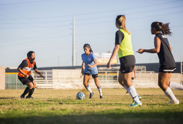 Western Warrior girls soccer midfielder and  captain Kirsten Molinaruns, senior, second from left, run with the ball during practice at Western High School, Wednesday, Nov. 9, 2016, in Las Vegas.  ...