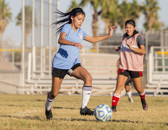 Western Warrior girls soccer midfielder and  captain Kirsten Molinaruns, senior, left, run with the ball during practice at Western High School, Wednesday, Nov. 9, 2016, in Las Vegas. Elizabeth Pa ...
