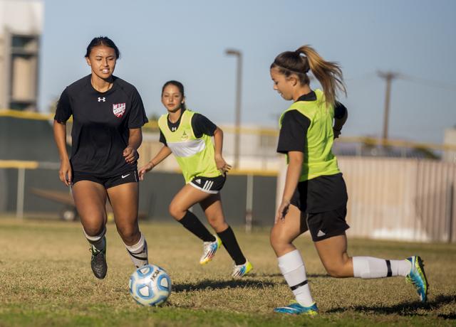 Western Warrior girls soccer midfielder  Ellyson Reynada, senior, left, runs with the ball during practice at Western High School, Wednesday, Nov. 9, 2016, in Las Vegas. Elizabeth Page Brumley/Las ...