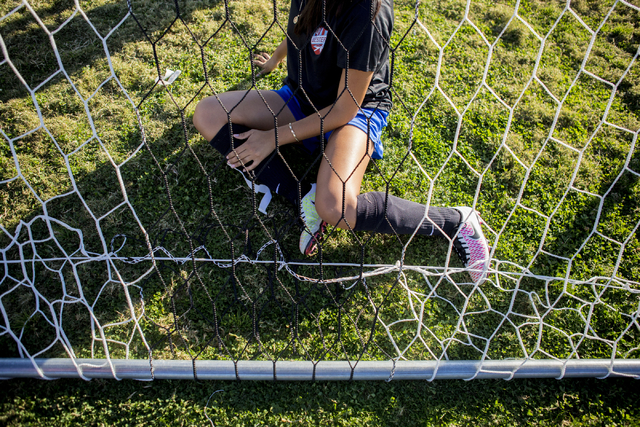A Western Warriors girls soccer teammate helps set up the net before practice at Western High School, Wednesday, Nov. 9, 2016, in Las Vegas. Elizabeth Page Brumley/Las Vegas Review-Journal Follow  ...