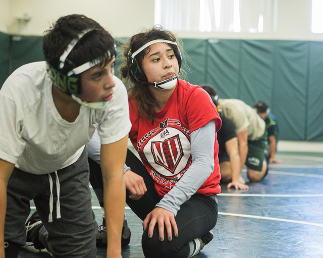 Leiana Nacapuy, in red, a Junior  Women's Freestyle Nationals All-American, listens during wrestling practice at Rancho High School on Monday, Dec. 5, 2016. (Jeff Scheid/Las Vegas Review-Journal)  ...