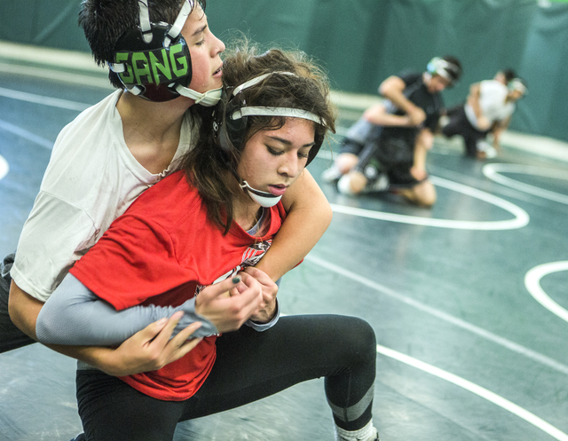 Leiana Nacapuy, in red, a Junior Women's Freestyle Nationals All-American, goes through wrestling drills with Humberto Duarte at Rancho High School on Monday, Dec. 5, 2016. (Jeff Scheid/Las Vegas  ...