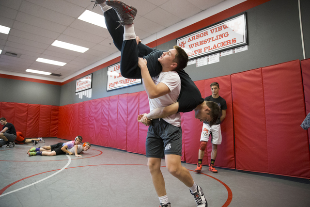 Ryder Marchello, left, 17, lifts Matthew Alejandro, 18, during a wrestling practice at Arbor View High School on Tuesday, Nov. 29, 2016, in Las Vegas. Erik Verduzco/Las Vegas Review-Journal Follow ...
