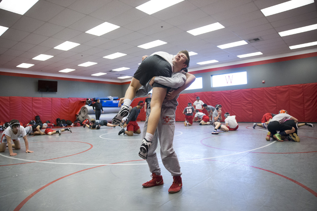 Dawson Downing, right, 17, lifts Ryder Marchello, 17, during a wrestling practice at Arbor View High School on Tuesday, Nov. 29, 2016, in Las Vegas. Erik Verduzco/Las Vegas Review-Journal Follow @ ...