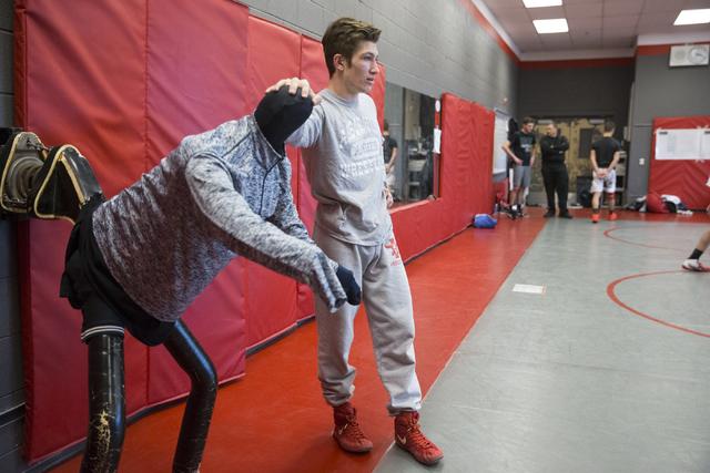 Dawson Downing, 17, watches his teammates wrestle during a practice at Arbor View High School on Tuesday, Nov. 29, 2016, in Las Vegas. Erik Verduzco/Las Vegas Review-Journal Follow @Erik_Verduzco