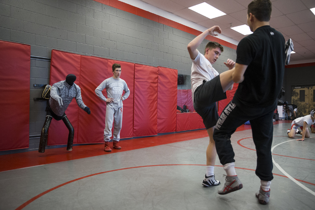 Dawson Downing, left, 17, watches his teammates wrestle during a practice at Arbor View High School on Tuesday, Nov. 29, 2016, in Las Vegas. Erik Verduzco/Las Vegas Review-Journal Follow @Erik_Ver ...