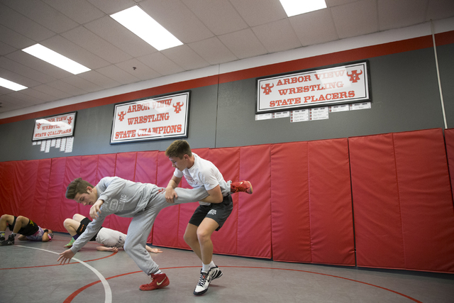 Dawson Downing, left, 17, and Ryder Marchello, 17, wrestle during practice at Arbor View High School on Tuesday, Nov. 29, 2016, in Las Vegas. Erik Verduzco/Las Vegas Review-Journal Follow @Erik_Ve ...