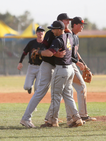 Faith Lutheran senior Brandon Johnson, center, receives a hug from shortstop Logan Etherington (4) after Johnson pitched a no-hitter against Bonanza on Wednesday. Johnson retired the final 19 batt ...